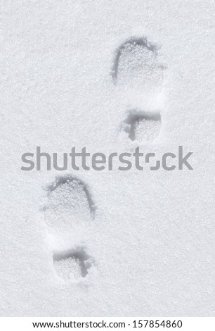 foot prints in snow  - stock photo