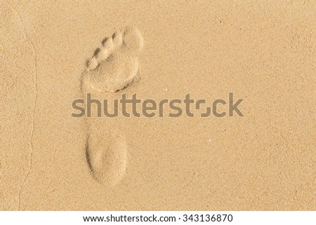 foot prints on sand at the beach in the afternoon, Phuket, Thailand - stock photo