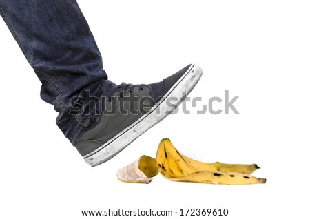 Foot, shoe about to slip on banana peel and have an accident  - stock photo