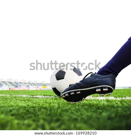 foot shooting football isolated - stock photo