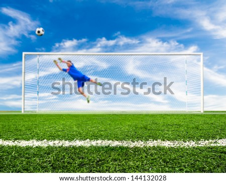 foot shooting soccer ball out of goal - stock photo