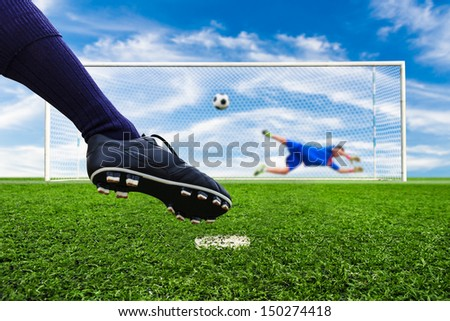 foot shooting soccer ball to goal, penalty - stock photo