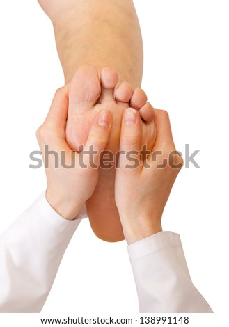 Foot sole treat massage reflexology and wellbeing - stock photo