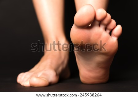 Foot stapping isolated on black - stock photo