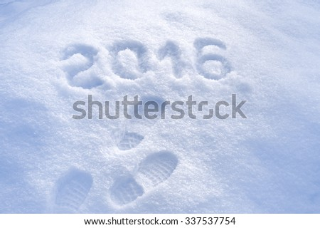 Foot step prints in snow, New Year 2016 greeting