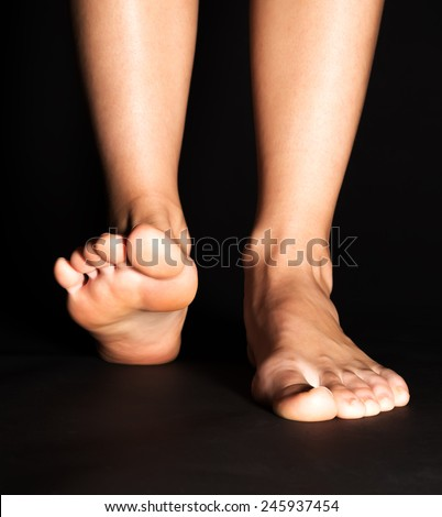 Foot stepping in black - stock photo