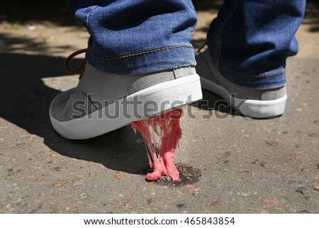 Foot stuck in chewing gum on street