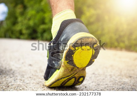 Foot with shoe of sports in foreground