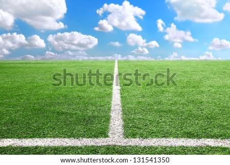 Football and soccer field grass stadium Blue sky background - stock photo