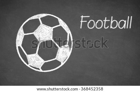 Football ball drawn on chalkboard. White chalk and balckboard