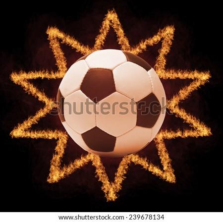 Football ball in firestar frame on black background, sports poster - stock photo