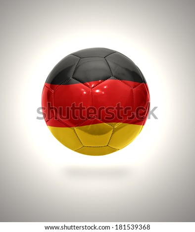 Football ball with the national flag of Germany on a gray background - stock photo