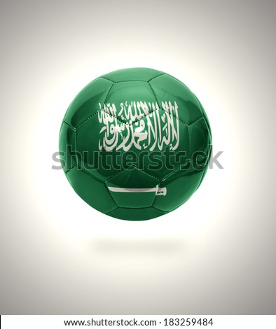 Football ball with the national flag of Saudi Arabia on a gray background - stock photo