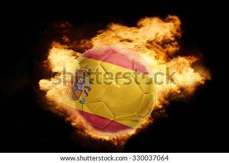 football ball with the national flag of spain on fire on a black background - stock photo