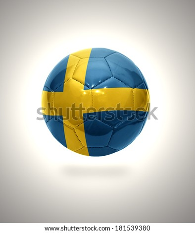 Football ball with the national flag of Sweden on a gray background - stock photo