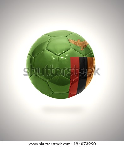 Football ball with the national flag of Zambia on a gray background - stock photo