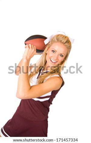 Football: Cheerleader Ready To Throw Football - stock photo