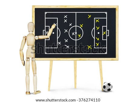 Football coach explains the plan for game. Abstract image with wooden puppet - stock photo