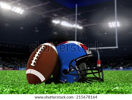 Football Equipment On Grass in Stadium with Spotlights - stock photo