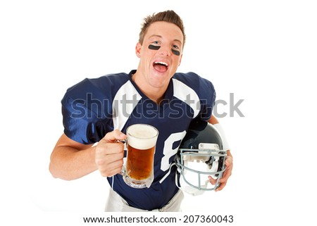 Football: Excited Player Holds Helmet And Mug Of Beer