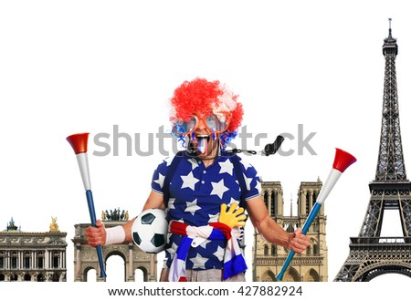 Football fan in a coloured wig and big glasses - stock photo