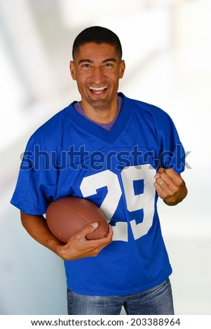 Football fan who is dressed in a jersey - stock photo