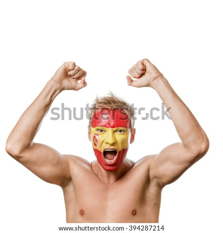 Football fan with spain flag painted over face isolated on white background - stock photo