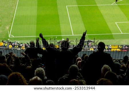 Football fans protest against a bad decision of the referee - stock photo