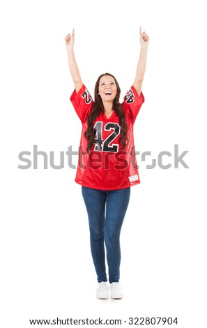 Football: Female Fan Pointing And Looking Up