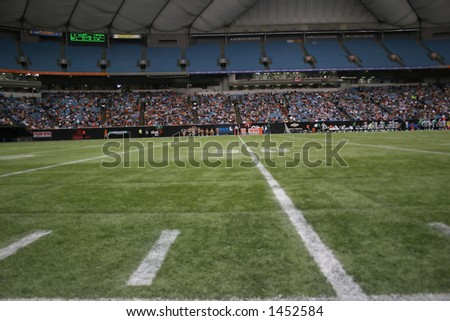 football field and stands - stock photo