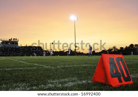Football field at the 40th yard at night - stock photo