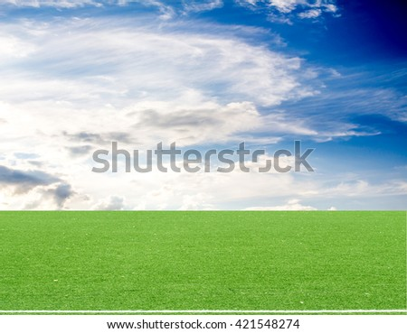football field blue sky with clouds - stock photo