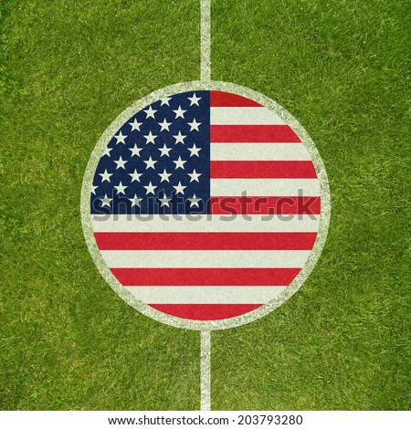 Football field center closeup with American flag in circle  - stock photo