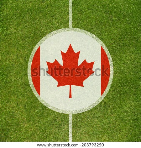 Football field center closeup with Canadian flag in circle  - stock photo