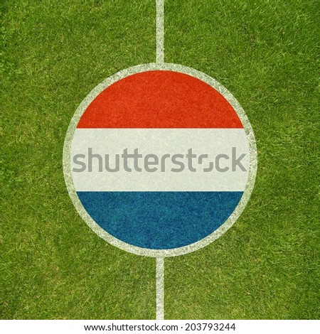Football field center closeup with Dutch flag in circle  - stock photo