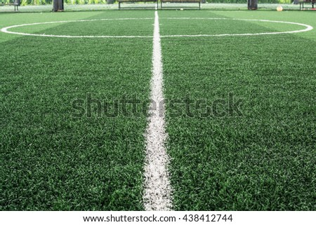 Football field made from artificial grass - stock photo