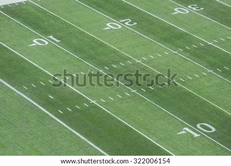 football field showing the goal line at the endzone - stock photo