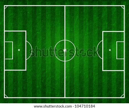 football field, soccer field with strips on green grass