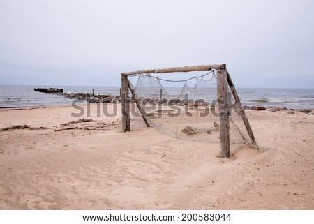 Football gate on beach vintage - stock photo