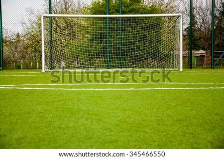 football gate on green sport court - stock photo