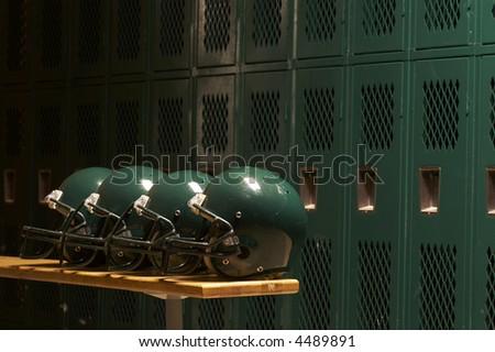 football helmets in locker room - stock photo