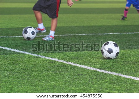 football in green grass with background Training children in Soccer academy - stock photo