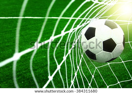 Football in net - stock photo