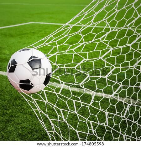 football in the goal net - stock photo