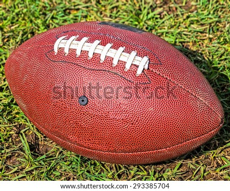 Football in the grass - stock photo