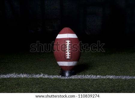 Football Kickoff on night background - stock photo