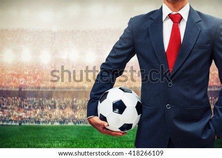 football manager holding soccer ball in the stadium