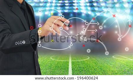 Football manager plan tactics. - stock photo