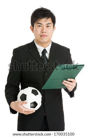 Football manager with soccer ball and tactcial board