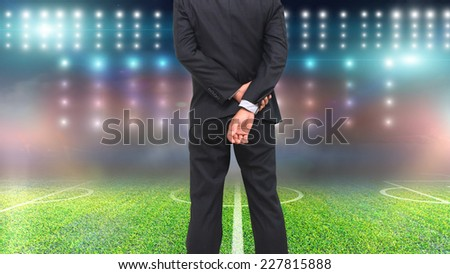 Football manager with soccer field and bright spotlights.  - stock photo